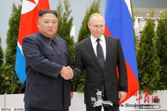 朝鲜发行金正恩普京会面纪念邮票印两人_朝鲜-俄罗斯-握手-