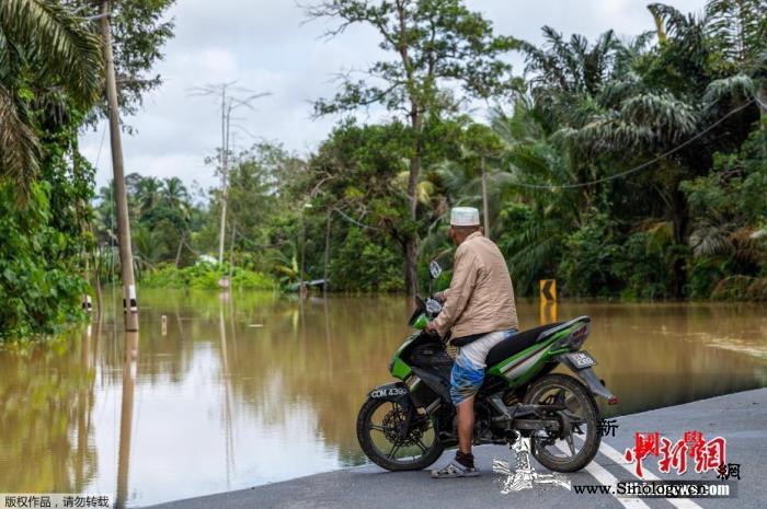 马来西亚豪雨致逾两万人受灾_阿卜杜拉-日中-马来西亚-